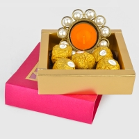 Metal diya and five Ferrero Rochers Chocolates combo