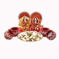 Laxmi Ganesha Idol with Cashews and Wax Diyas